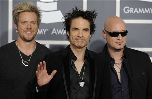 From left, Scott Underwood, Patrick Monahan and Jimmy Stafford  of music group Train arrive at the 53rd annual Grammy Awards on Sunday, Feb. 13, 2011, in Los Angeles. &#40;AP Photo&#47;Chris Pizzello&#41; <span class=meta>(AP Photo&#47; Chris Pizzello)</span>