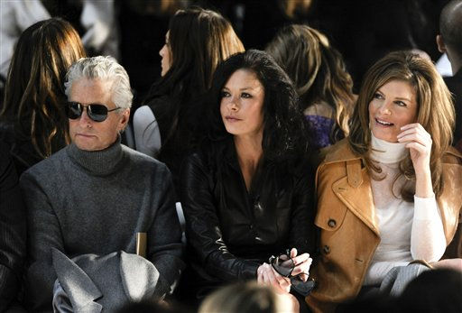 "<div class=""meta image-caption""><div class=""origin-logo origin-image ""><span></span></div><span class=""caption-text"">Actors, from left, Michael Douglas, Catherine Zeta-Jones and Rene Russo attend the Michael Kors Fall 2011 fashion show during Mercedes-Benz Fashion Week on Wednesday, Feb. 16, 2011 in New York.   (AP Photo/ Evan Agostini)</span></div>"