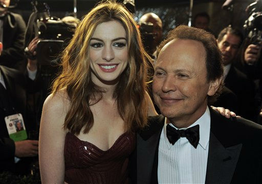 Billy Crystal and Anne Hathaway are seen at the Governors Ball following the 83rd Academy Awards on Sunday, Feb. 27, 2011, in the Hollywood section of Los Angeles. &#40;AP Photo&#47;Chris Pizzello&#41; <span class=meta>(AP Photo&#47; Chris Pizzello)</span>