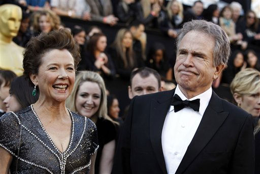 "<div class=""meta image-caption""><div class=""origin-logo origin-image ""><span></span></div><span class=""caption-text"">Actress Annette Bening, left, and husband Warren Beatty arrive before the 83rd Academy Awards on Sunday, Feb. 27, 2011, in the Hollywood section of Los Angeles.   (AP Photo/ Matt Sayles)</span></div>"