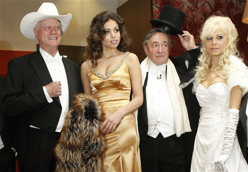 US actor Larry Hagman, Karima el-Mahroug, Austrian businessman Richard Lugner and his girlfriend Anastasia Sokol, from left, pose for photographers prior to the Opera Ball in Vienna, Austria, on Thursday, March 3, 2011. Karima el-Mahroug nicknamed Ruby and Hagman will be guests of Austrian businessman Richard Lugner at this year&#39;s Opera Ball.   <span class=meta>(AP Photo&#47; Ronald Zak)</span>