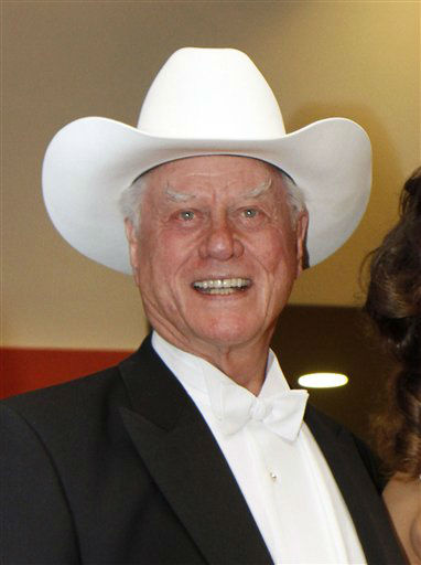 "<div class=""meta ""><span class=""caption-text "">In this March 3, 2011 file photo, U.S. actor Larry Hagman, known for his roles on ""I Dream of Jeannie,"" and ""Dallas,"" poses at the Opera ball in Vienna, Austria. Hagman has been diagnosed with cancer. He declined to specify what kind of cancer he's contracted, but said it's ?a very common and treatable form.?  (AP Photo/ Ronald Zak)</span></div>"