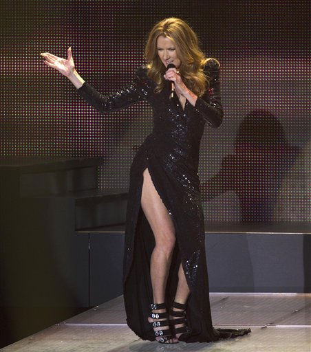 Celine Dion sings a montage from James Bond movies during her opening night performance at Caesar&#39;s Palace, Tuesday, March 15, 2011, in Las Vegas.  <span class=meta>(AP Photo&#47; Julie Jacobson)</span>