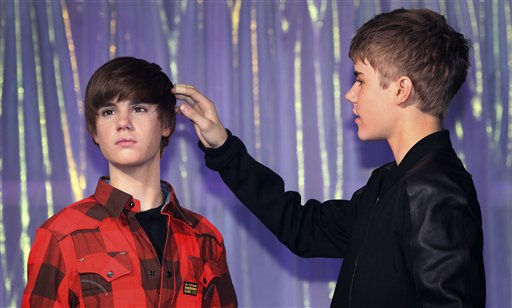 Canadian musician Justin Bieber, checks the hair of the new waxwork figure of himself, at Madame Tussaud&#39;s in London, Tuesday, March. 15, 2011.   <span class=meta>(AP Photo&#47; Joel Ryan)</span>