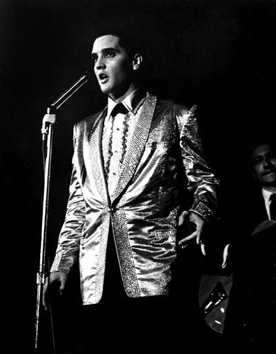 In this photo taken March 25, 1961 and provided by the World War II Valor in the Pacific National Monument, Elvis Presley performs at the Bloch Arena on the Pearl Harbor Navel base in Honolulu, Hawaii. Fifty years ago, Elvis Presley helped raise money and bring attention to help build the USS Arizona Memorial. The King is being asked to deliver one more time.  &#40;AP Photo&#47; Word War II Valor in the Pacific National Monument&#41; <span class=meta>(AP Photo&#47; Anonymous)</span>