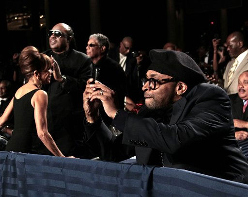 Filmmaker Spike Lee, right, uses his smartphone to take a picture of President Barack Obama at the National Action Network&#39;s Keepers of Dream Awards Gala in New York, Wednesday, April 6, 2011. On the left applauding is recording artist Stevie Wonder.  <span class=meta>(AP Photo&#47; Pablo Martinez Monsivais)</span>