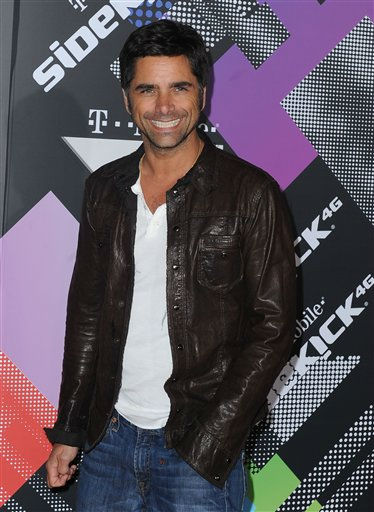 "<div class=""meta image-caption""><div class=""origin-logo origin-image ""><span></span></div><span class=""caption-text"">John Stamos arrives to The T-Mobile Sidekick 4G Launch Party on Sunday April 20, 2011, in Beverly Hills, Calif. Stamos is one of the celebrities rumored to in the cast of season 13 of 'Dancing with the Stars' which premieres September 19 at 7pm on ABC13. (AP Photo/Katy Winn)</span></div>"