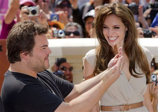 "<div class=""meta image-caption""><div class=""origin-logo origin-image ""><span></span></div><span class=""caption-text"">Actors Jack Black, left, and Angelina Jolie pose during a photo call for Kung Fu Panda 2, at the 64th international film festival, in Cannes, southern France, Thursday, May 12, 2011.   (AP Photo/ Joel Ryan)</span></div>"