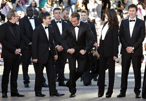 From left, cinematographer Guillaume Schiffman, producer Thomas Langmann, actor Jean Dujardin, Berenice Bejo and director Michel Hazanavicius arrive for the screening of The Artist at the 64th international film festival, in Cannes, southern France, Sunday, May 15, 2011. &#40;AP Photo&#47;Lionel Cironneau&#41; <span class=meta>(Photo&#47;Lionel Cironneau)</span>