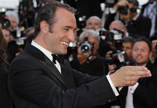 "<div class=""meta image-caption""><div class=""origin-logo origin-image ""><span></span></div><span class=""caption-text"">Actor Jean Dujardin poses on the red carpet for the screening of The Artist at the 64th international film festival, in Cannes, southern France, Sunday, May 15, 2011. (AP Photo/Joel Ryan) (Photo/Joel Ryan)</span></div>"