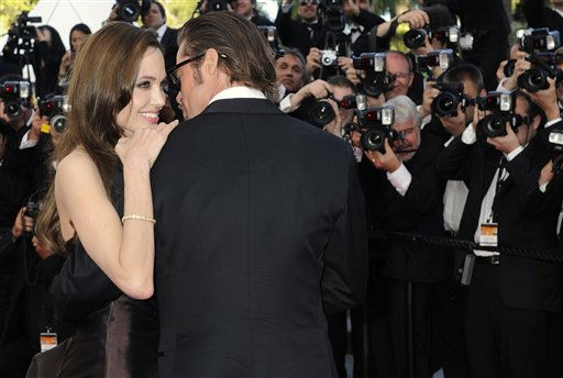 "<div class=""meta ""><span class=""caption-text "">Actors Brad Pitt and Angelina Jolie pose on the red carpet for the screening of The Tree of Life at the 64th international film festival, in Cannes, southern France, Monday, May 16, 2011.   (AP Photo/ Jonathan Short)</span></div>"