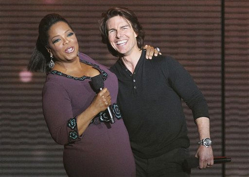 "<div class=""meta ""><span class=""caption-text "">Tom Cruise, right, appears with Oprah Winfrey during a star-studded double-taping of ""Surprise Oprah! A Farewell Spectacular,"" Tuesday, May 17, 2011, in Chicago. ""The Oprah Winfrey Show"" is ending its run May 25, after 25 years, and millions of her fans around the globe are waiting to see how she will close out a show that spawned a media empire.   (AP Photo/ Charles Rex Arbogast)</span></div>"