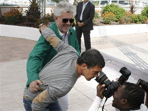 "<div class=""meta image-caption""><div class=""origin-logo origin-image ""><span></span></div><span class=""caption-text"">Actor Antonio Banderas, center, peers into a photographers lens as he and director Pedro Almodovar pose during a photo call for The Skin I Live In, at the 64th international film festival, in Cannes, southern France, Thursday, May 19, 2011.   (AP Photo/ Lionel Cironneau)</span></div>"