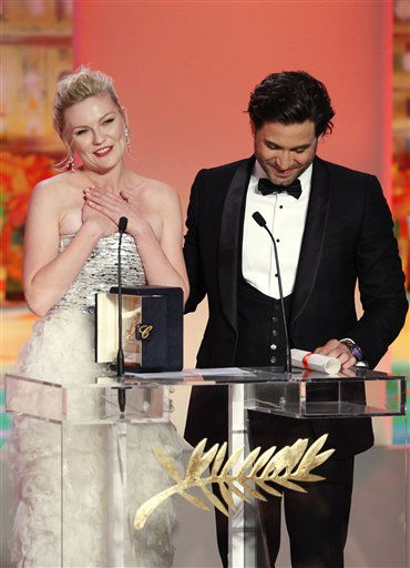 "<div class=""meta ""><span class=""caption-text "">Actress Kirsten Dunst, left, accepts the Best Actress award for the film Melancholia during the awards ceremony at the 64th international film festival, in Cannes, southern France, Sunday, May 22, 2011.  (AP Photo/ Francois Mori)</span></div>"