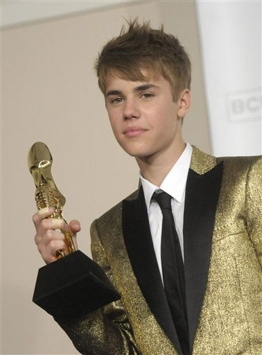 "<div class=""meta image-caption""><div class=""origin-logo origin-image ""><span></span></div><span class=""caption-text"">Singer Justin Bieber poses in the press room at the 2011 Billboard Music Awards in Las Vegas on Sunday, May 22, 2011. (AP Photo/Dan Steinberg) (AP Photo/ Dan Steinberg)</span></div>"