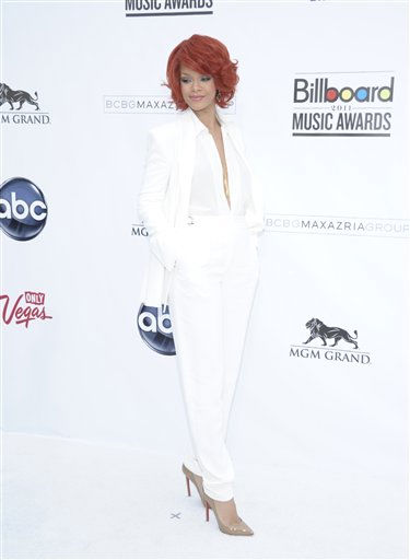 "<div class=""meta image-caption""><div class=""origin-logo origin-image ""><span></span></div><span class=""caption-text"">Singer Rihanna arrives at the 2011 Billboard Music Awards in Las Vegas on Sunday, May 22, 2011. (AP Photo/Dan Steinberg) (AP Photo/ Dan Steinberg)</span></div>"