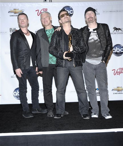 From left to right, Larry Mullen, Jr., Adam Clayton, Bono, and The Edge of the rock band U2 pose in the press room with their award at the 2011 Billboard Music Awards in Las Vegas on Sunday, May 22, 2011. &#40;AP Photo&#47;Dan Steinberg&#41; <span class=meta>(AP Photo&#47; Dan Steinberg)</span>