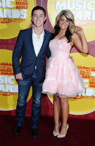 American Idol winner Scotty McCreery and runner-up Lauren Alaina arrive at the 2011 CMT Music Awards in Nashville, Tenn. on Wednesday, June 8, 2011.  &#40;AP Photo&#47;Charles Sykes&#41; <span class=meta>(AP Photo&#47; Charles Sykes)</span>