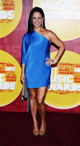 Sara Evans arrives at the 2011 CMT Music Awards in Nashville, Tenn. on Wednesday, June 8, 2011.  &#40;AP Photo&#47;Charles Sykes&#41; <span class=meta>(AP Photo&#47; Charles Sykes)</span>
