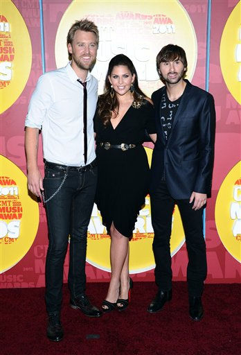From left to right, Dave Haywood, Hillary Scott, and Charles Kelley of Lady Antebellum arrive at the 2011 CMT Music Awards in Nashville, Tenn. on Wednesday, June 8, 2011.  &#40;AP Photo&#47;Charles Sykes&#41; <span class=meta>(AP Photo&#47; Charles Sykes)</span>
