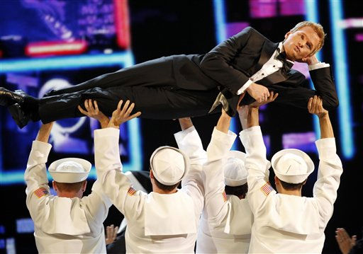 "<div class=""meta image-caption""><div class=""origin-logo origin-image ""><span></span></div><span class=""caption-text"">Host Neil Patrick Harris performs during the 65th annual Tony Awards, Sunday, June 12, 2011 in New York.   (AP Photo/ Jeff Christensen)</span></div>"