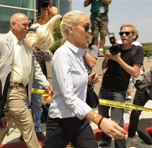"<div class=""meta image-caption""><div class=""origin-logo origin-image ""><span></span></div><span class=""caption-text"">Lindsay Lohan exits the courthouse following a probation hearing at LAX Courthouse, Thursday, June 23, 2011, in Los Angeles. Prosecutors say Lohan's court appearance related to her drunken driving case, not a misdemeanor theft case the actress resolved with a no-contest plea in May.   (AP Photo/ Chris Pizzello)</span></div>"