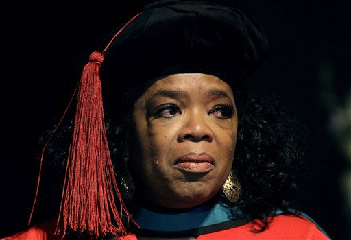 Oprah Winfrey reacts after receiving an honorary doctorate in education from Prof. Dennis Francis, unseen, during her graduation ceremony at the Free State University in Bloemfontein, South Africa, Friday, June 24,  2011.  A central South African university known for fraught race relations awarded an honorary education doctorate to Oprah Winfrey Friday, and her visit was welcomed as an acknowledgment of the progress the institution has made toward tolerance.  <span class=meta>(AP Photo&#47; Themba Hadebe)</span>
