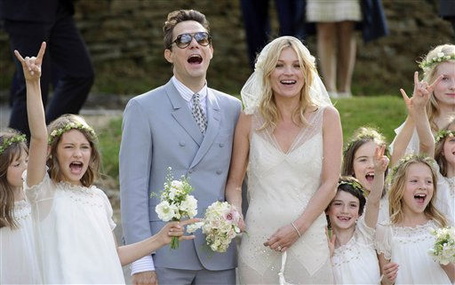 British model Kate Moss and British guitarist Jamie Hince pose for photographers with unidentified bridesmaids, after their wedding in the village of Southrop, England, Friday, July 1, 2011.  <span class=meta>(AP Photo&#47; Jonathan Short)</span>