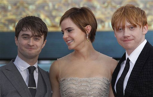 British actors, left to right, Daniel Radcliffe, Emma Watson and Rupert Grint, Trafalgar Square, in central London, for the World Premiere of &#34;Harry Potter and the Deathly Hallows: Part 2&#34; the last film in the series, Thursday, July 7, 2011. Harry Potter&#39;s saga is ending, but his magic spell remains. Thousands of fans from around the world massed in London Thursday for the premiere of the final film in the magical adventure series.   <span class=meta>(AP Photo&#47; Joel Ryan)</span>