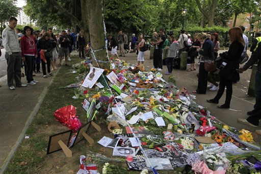 "<div class=""meta ""><span class=""caption-text "">People look at flowers and tributes left for British singer Amy Winehouse outside her house in London, Tuesday, July 26, 2011. Winehouse, 27, was found dead in her house Saturday and her funeral takes place later Tuesday. (AP Photo/Sang Tan) (AP Photo/ Sang Tan)</span></div>"