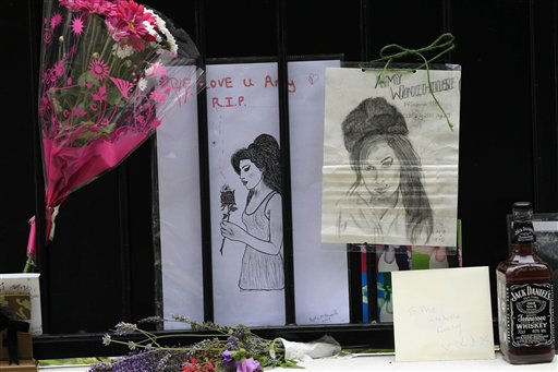 "<div class=""meta image-caption""><div class=""origin-logo origin-image ""><span></span></div><span class=""caption-text"">Flowers and tributes are left for British singer Amy Winehouse outside her house in London, Tuesday, July 26, 2011. Amy Winehouse was found dead in her house Saturday and her funeral takes place Tuesday. (AP Photo/Sang Tan) (AP Photo/ Sang Tan)</span></div>"