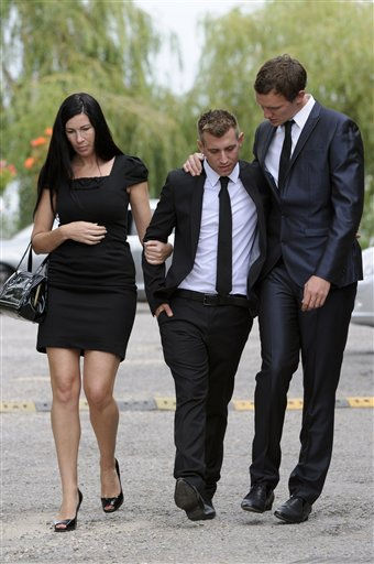 Mourners react as they leave Edgwarebury Cemetery in London, Tuesday July 26, 2011, after attending the funeral of singer Amy Winehouse.  The soul diva, who had battled alcohol and drug addiction, was found dead Saturday at her London home. She was 27. &#40;AP Photo&#47;Jonathan Short&#41; <span class=meta>(AP Photo&#47; Jonathan Short)</span>