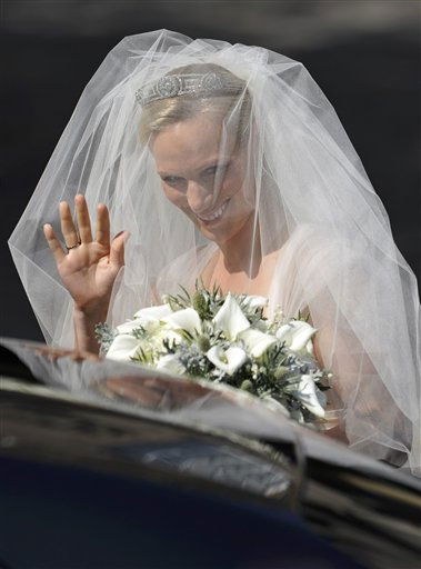 Britain&#39;s Zara Phillips, granddaughter of Britain&#39;s Queen Elizabeth II, arrives for her marriage to England rugby star Mike Tindall, at Canongate Kirk in Edinburgh, Scotland, Saturday, July 30, 2011.  <span class=meta>(AP Photo&#47; Dylan Martinez)</span>