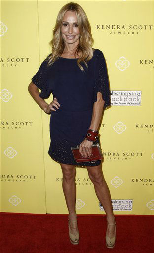"<div class=""meta image-caption""><div class=""origin-logo origin-image ""><span></span></div><span class=""caption-text"">Reality television personality Taylor Armstrong arrives at the grand opening party for Kendra Scott Jewelry's Beverly Hills Store benefiting Blessings in a Backpack in West Hollywood, Calif., Wednesday, Aug. 10, 2011. She is one of the celebrities rumored to be dancing on the 14th season of 'Dancing with the Stars' on ABC. The official cast will be revealed on February 28 on ABC. (AP Photo/ Matt Sayles)</span></div>"