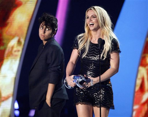 Britney Spears accepts the Video Vanguard award at the MTV Video Music Awards on Sunday Aug. 28, 2011, in Los Angeles. In background looking on at left is presenter Lady Gaga.  <span class=meta>(AP Photo&#47; Matt Sayles)</span>