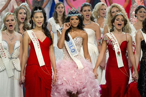 Miss Venezuela Ivian Sarcos, center, waves...