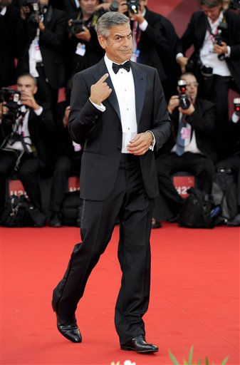 US actor George Clooney arrives on the red carpet for the premiere of his movie &#39;The Ides of March&#39;, which opens the 68th edition of the Venice Film Festival in Venice, Italy, Wednesday, Aug. 31, 2011.   <span class=meta>(AP Photo&#47; Jonathan Short)</span>