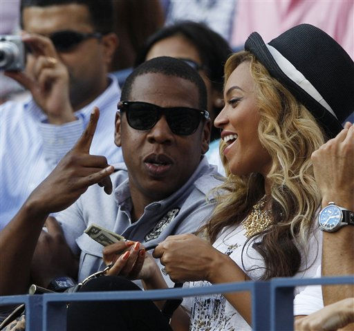 Jay-Z talks to Beyonce during the men&#39;s championship match between Novak Djokovic of Serbia and Rafael Nadal of Spain at the U.S. Open tennis tournament in New York, Monday, Sept. 12, 2011.  <span class=meta>(AP Photo&#47; Elise Amendola)</span>