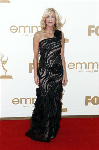 "<div class=""meta ""><span class=""caption-text "">'Good Morning America' co-host Lara Spencer arrives at the 63rd Primetime Emmy Awards on Sunday, Sept. 18, 2011 in Los Angeles. She is one of the celebrities rumored to be dancing on the 14th season of 'Dancing with the Stars' on ABC. The official cast will be revealed on February 28 on ABC. (AP Photo/ Matt Sayles)</span></div>"