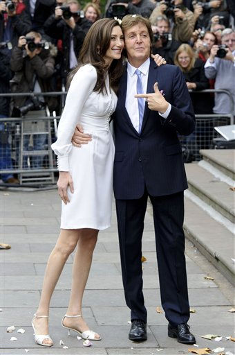 "<div class=""meta ""><span class=""caption-text "">Former Beatle Paul McCartney and American heiress Nancy Shevell are seen after their wedding at Marylebone Town Hall, London, Sunday, Oct. 9, 2011. McCartney and Shevell were married on Sunday, emerging joyously from a 45-minute civil marriage ceremony to be showered with confetti from fans. (AP Photo/Jonathan Short) (AP Photo/ Jonathan Short)</span></div>"