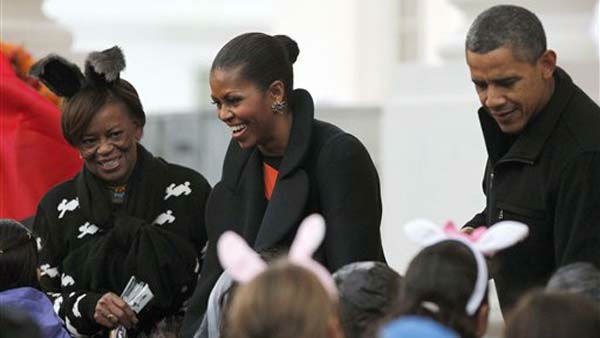 President Barack Obama, right, first lady Michelle Obama, center, her mother Marian Robinson, left, hand out Halloween treats as they welcome children from the Washington area and military members and their families to trick-or-treat at the White House in Washington, Saturday, Oct., 29, 2011. &#40;AP Photo&#47;Pablo Martinez Monsivais&#41; <span class=meta>(AP Photo&#47; Pablo Martinez Monsivais)</span>