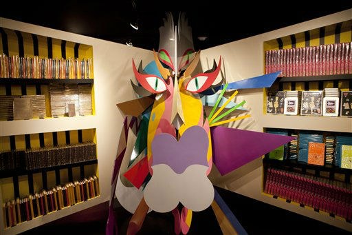 A bookshelf and facade are displayed at Gaga&#39;s Workshop, a collaborative fashion and lifestyle project between Lady Gaga and Barney&#39;s New York, at the Barney&#39;s store on East 60th Street in New York on Monday, Nov. 21, 2011. &#40;AP Photo&#47;Andrew Burton&#41; <span class=meta>(AP Photo&#47; Andrew Burton)</span>