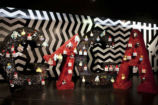 Ornaments and accessories hang on a display spelling &#34;GAGA&#34; at Gaga&#39;s Workshop, a collaborative fashion and lifestyle project between Lady Gaga and Barney&#39;s New York, at the Barney&#39;s store on East 60th Street in New York on Monday, Nov. 21, 2011. &#40;AP Photo&#47;Andrew Burton&#41; <span class=meta>(AP Photo&#47; Andrew Burton)</span>