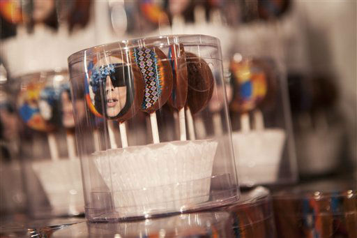 Candy, including some with a likeness of Lady Gaga on them, are displayed at Gaga&#39;s Workshop, a collaborative fashion and lifestyle project between Lady Gaga and Barney&#39;s New York, at the Barney&#39;s store on East 60th Street in New York on Monday, Nov. 21, 2011. &#40;AP Photo&#47;Andrew Burton&#41; <span class=meta>(AP Photo&#47; Andrew Burton)</span>