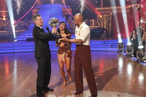 In this image released by ABC-TV, war veteran and actor J.R. Martinez, right, and his partner Karina Smirnoff hold their award with host Tom Bergeron after they were crowned champions of the celebrity dance competition series, &#34;Dancing with the Stars,&#34; Tuesday, Nov. 22, 2011 in Los Angeles. &#40;AP Photo&#47;ABC-TV, Adam Taylor&#41; <span class=meta>(AP Photo&#47; Adam Taylor)</span>