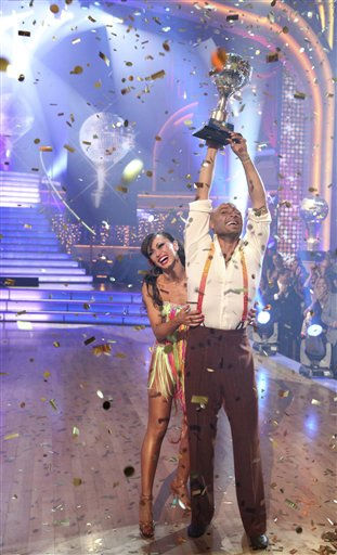 In this image released by ABC-TV, war veteran and actor J.R. Martinez, right, and his partner Karina Smirnoff hold their award after they were crowned champions of the celebrity dance competition series, &#34;Dancing with the Stars,&#34; Tuesday, Nov. 22, 2011 in Los Angeles. &#40;AP Photo&#47;ABC-TV, Adam Taylor&#41; <span class=meta>(AP Photo&#47; Adam Taylor)</span>