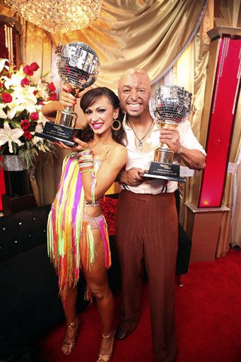 In this image released by ABC-TV, war veteran and actor J.R. Martinez, right, and his partner Karina Smirnoff hold their awards after they were crowned champions of the celebrity dance competition series, &#34;Dancing with the Stars,&#34; Tuesday, Nov. 22, 2011 in Los Angeles. &#40;AP Photo&#47;ABC-TV, Adam Taylor&#41; <span class=meta>(AP Photo&#47; Adam Taylor)</span>