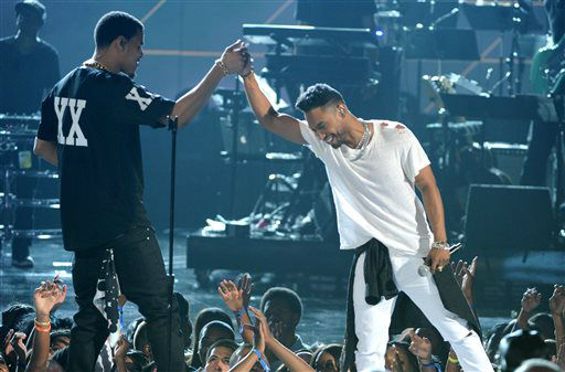 "<div class=""meta image-caption""><div class=""origin-logo origin-image ""><span></span></div><span class=""caption-text"">J. Cole, left, and singer Miguel perform onstage at the BET Awards at the Nokia Theatre on Sunday, June 30, 2013, in Los Angeles. (Photo by Frank Micelotta/Invision/AP) (AP Photo/ Frank Micelotta)</span></div>"