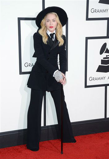 "<div class=""meta image-caption""><div class=""origin-logo origin-image ""><span></span></div><span class=""caption-text"">Madonna arrives at the 56th annual GRAMMY Awards at Staples Center on Sunday, Jan. 26, 2014, in Los Angeles.  (Photo by Jordan Strauss/Invision/AP)</span></div>"