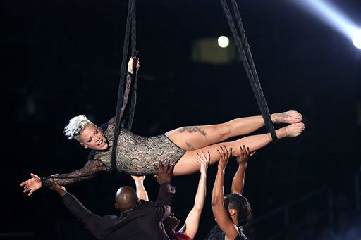 "<div class=""meta image-caption""><div class=""origin-logo origin-image ""><span></span></div><span class=""caption-text"">Pink performs at the 56th annual Grammy Awards at Staples Center on Sunday, Jan. 26, 2014, in Los Angeles. (Photo by Matt Sayles/Invision/AP) (Photo/Matt Sayles)</span></div>"